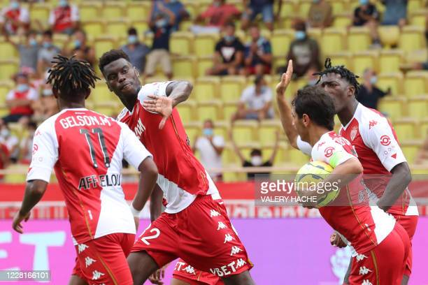 Monaco's French defender Benoit Badiashile celebrates with teammates after scoring a goal during the French L1 football match between AS Monaco and...