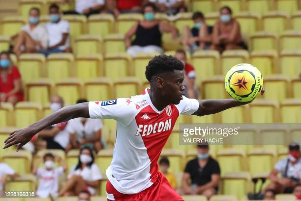 Monaco's French defender Benoit Badiashile controls the ball as he prepares to score a goal during the French L1 football match between AS Monaco and...