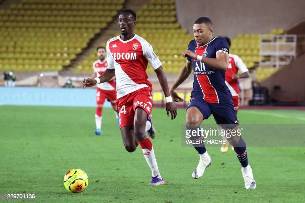 Monaco's French defender Chrislain Matsima vies for the ball with Paris Saint-Germain's French forward Kylian Mbappe during the French L1 football...