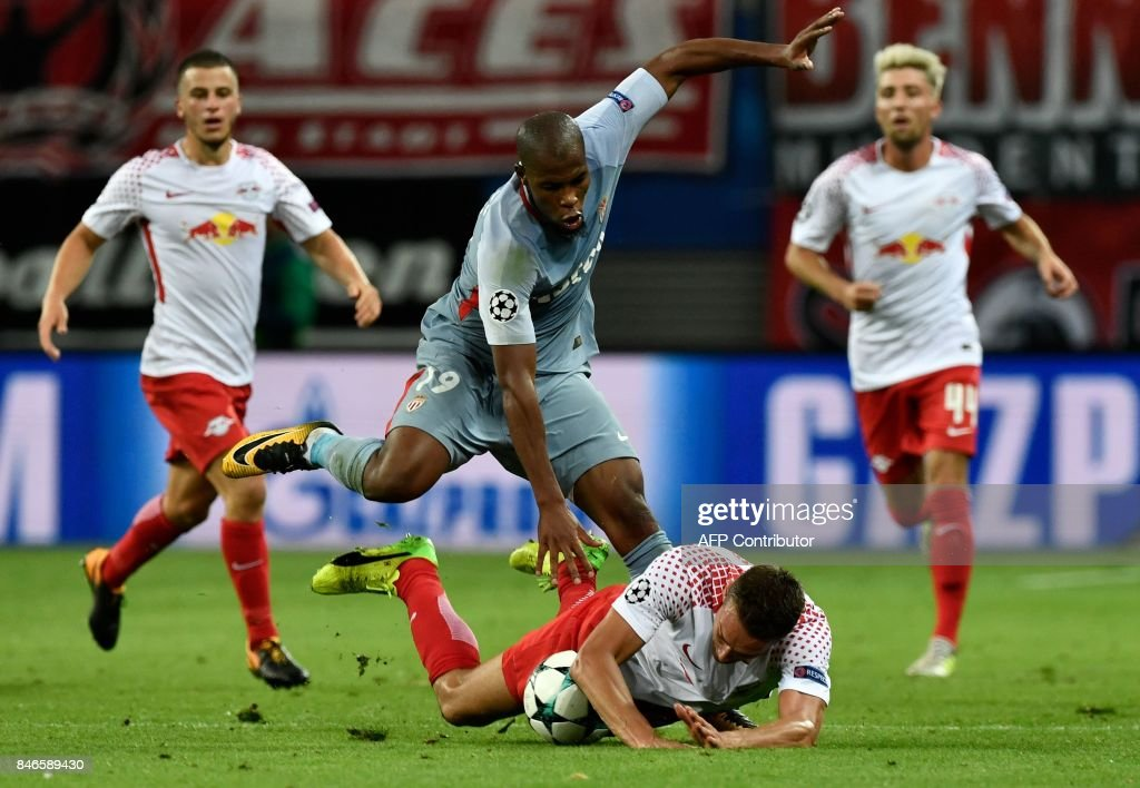 Monaco's French defender Djibril Sidibe and Leipzig's Austrian midfielder Stefan Ilsanker (below) vie for the ball during the UEFA Champions League group G football match RB Leipzig v AS Monaco in Leipzig, eastern Germany on September 13, 2017. / AFP PHOTO / John MACDOUGALL