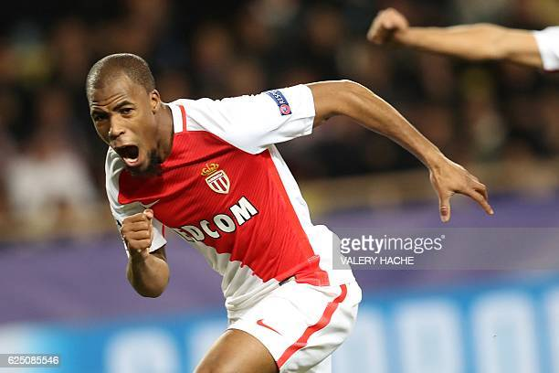 Monaco's French defender Djibril Sidibe celebrates after scoring their first goal during the UEFA Champions League group E football match AS Monaco...