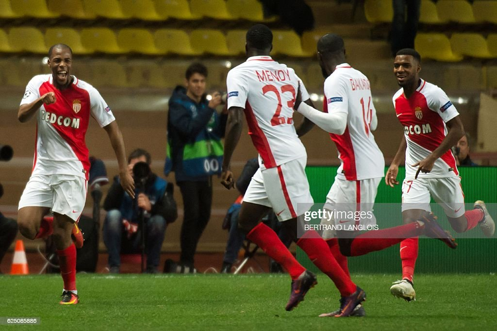 Monaco's French defender Djibril Sidibe (L) celebrates with his teammates after scoring during the UEFA Champions League group E football match AS Monaco and Tottenham Hotspur FC at the Louis II stadium in Monaco on November 22, 2016. / AFP / BERTRAND