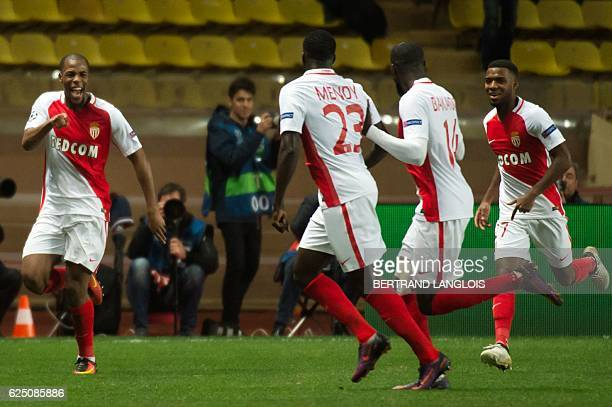 Monaco's French defender Djibril Sidibe celebrates with his teammates after scoring during the UEFA Champions League group E football match AS Monaco...