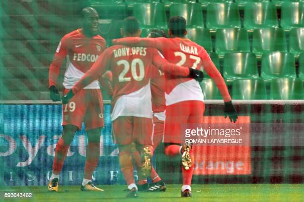 Monaco's French defender Djibril Sidibe celebrates with teammates after scoring a goal during the French L1 football match between SaintEtienne and...