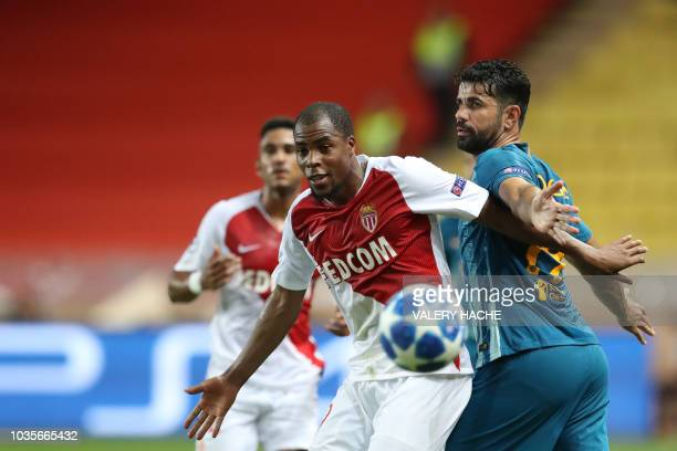 Monaco's French defender Djibril Sidibe eyes the ball as he vies for it with Atletico Madrid's Spanish forward Diego Costa during the UEFA Champions...