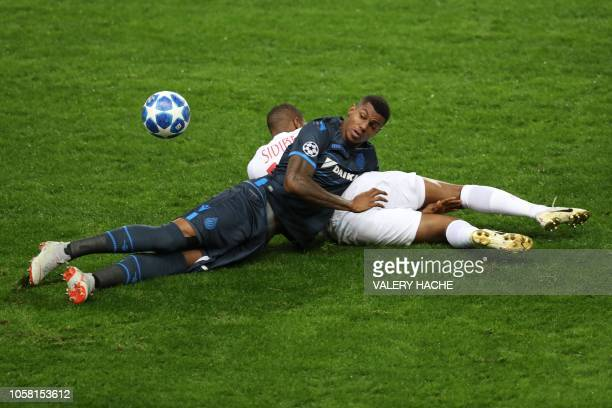 Monaco's French defender Djibril Sidibe fights for the ball with Club Brugge's Brazilian forward Wesley Moraes during the UEFA Champions League Group...