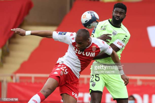 Monaco's French defender Djibril Sidibe fights for the ball with Dijon's Gabonese defender Bruno Ecuele Manga during the French L1 football match...