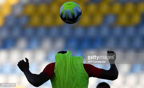 TOPSHOT Monaco's French defender Djibril Sidibe heads the ball during a training session at the Grand Stade in Tangiers on July 28 2017 on the eve of...