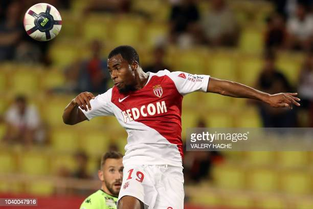 Monaco's French defender Djibril Sidibe heads the ball during the French L1 football match Monaco vs Angers on September 25 2018 at the Louis II...