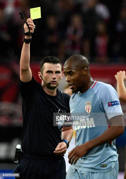 Monaco's French defender Djibril Sidibe is given a yellow card by English referee Michael Oliver during the UEFA Champions League group G football...