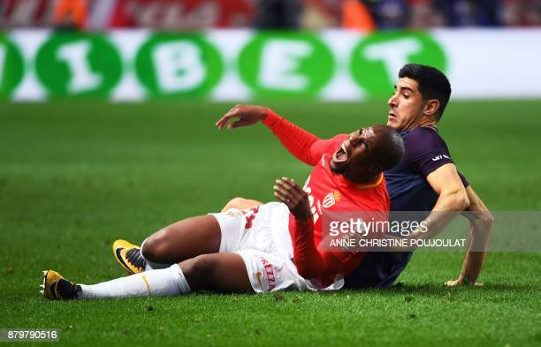 Monaco's French defender Djibril Sidibe reacts as he falls with Paris SaintGermain's Spanish defender Yuri Berchiche during the French L1 football...