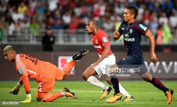 Monaco's French defender Djibril Sidibe reacts as he scores a goal past next to Paris SaintGermain's French goalkeeper Alphonse Areola and Paris...