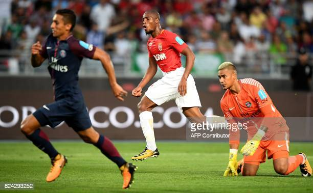 Monaco's French defender Djibril Sidibe reacts as he scores a goal past next to Paris SaintGermain's French goalkeeper Alphonse Areola and Paris...