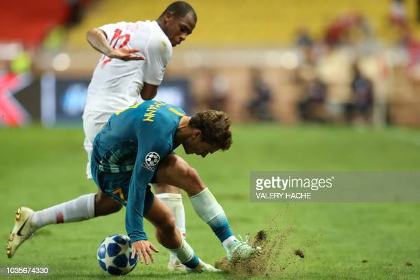 Monaco's French defender Djibril Sidibe vies for the ball with Atletico Madrid's French forward Antoine Griezmann during the UEFA Champions League...