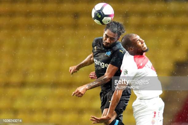 Monaco's French defender Djibril Sidibe vies with Marseille's French defender Jordan Amavi during the French L1 football match between AS Monaco and...