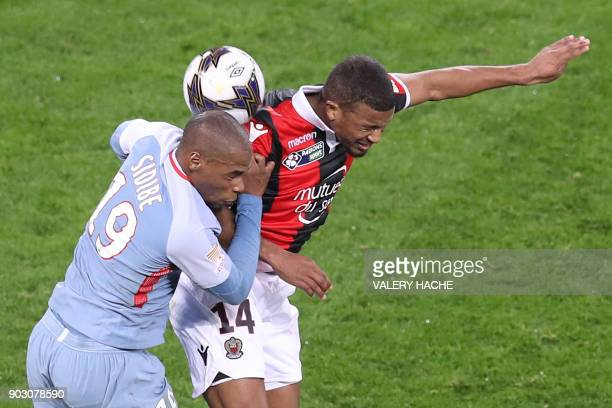 Monaco's French defender Djibril Sidibe vies with Nice's French forward Alassane Plea during the French League Cup football match between Nice and...
