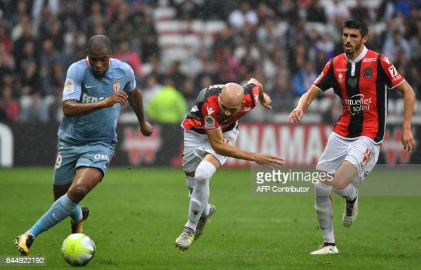 Monaco's French defender Djibril Sidibe vies with Nice's French defender Christophe Jallet during the French L1 football match Nice vs Monaco on...