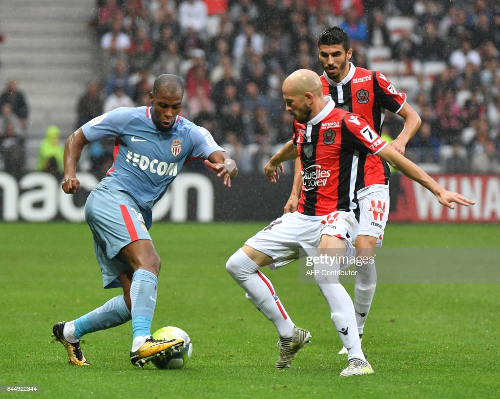 Monaco's French defender Djibril Sidibe vies with Nice's French defender Christophe Jallet during the French L1 football match Nice (OGCN) vs Monaco (ASM) on September 9, 2017 at the 'Allianz Riviera' stadium in Nice, southeastern France. /
