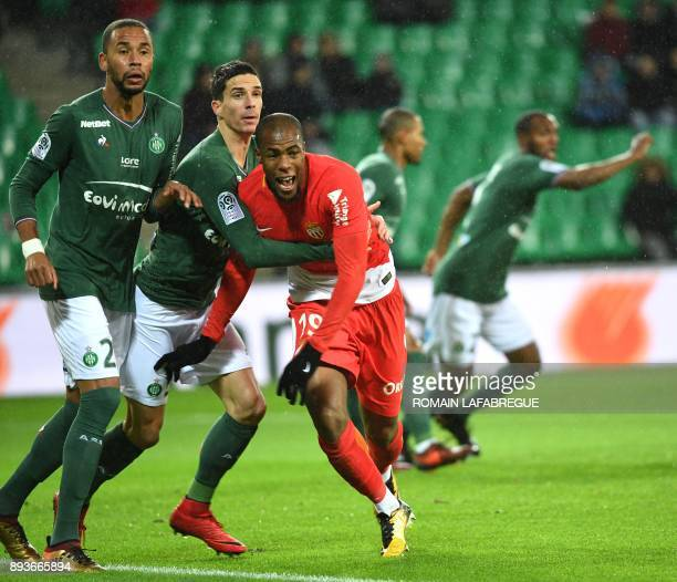 Monaco's French defender Djibril Sidibe vies with SaintEtienne's French midfielder Vincent Pajot and French defender Kevin TheophileCatherine during...