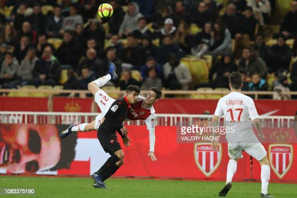 Monaco's French defender Julien Serrano vies with Nice's Algerian defender Youcef Atal during the French L1 football match between Monaco and Nice on...