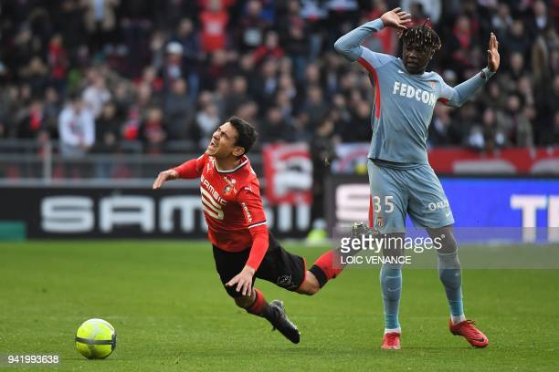Monaco's French defender Kevin N'Doram vies Rennes' French midfielder Benjamin Andre during the French L1 football match Rennes vs Monaco at the...
