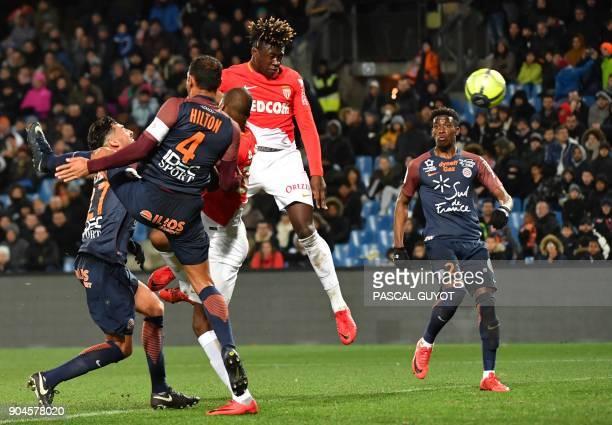 Monaco's French defender Kevin Ndoram vies with Montpellier's Brazilian defender Vitorino Hilton and Montpellier's Uruguayan midfielder Facundo Piriz...