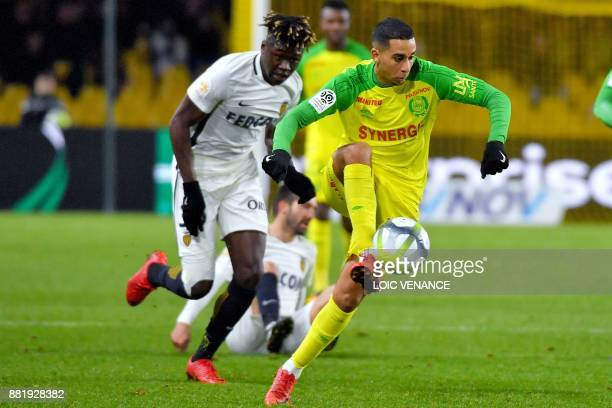 Monaco's French defender Kevin Ndoram vies with Nantes' BelgianMoroccan mildfielder Yassine EL Ghanassy during the French L1 football match Nantes vs...