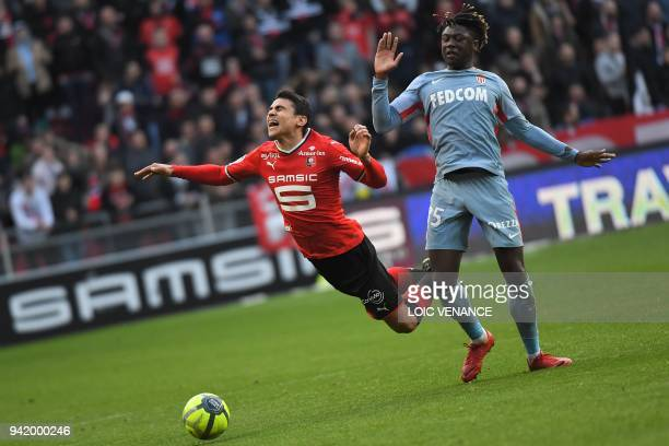 Monaco's French defender Kevin N'Doram vies with Rennes' French midfielder Benjamin Andre during the French L1 football match Rennes vs Monaco at the...