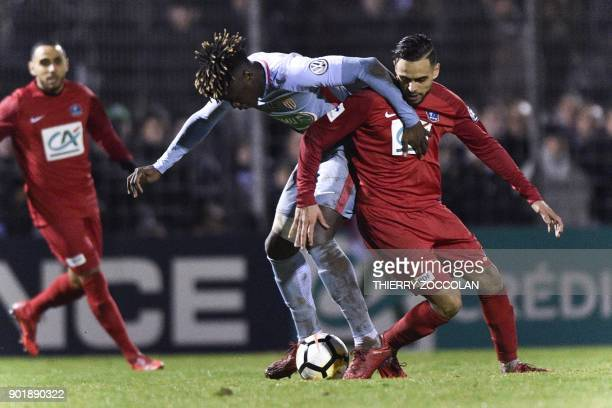 Monaco's French defender Kevin Ndoram vies with Yzeure's French forward Samy Alouache during the French Cup Football match between Yzeure abd Monaco...