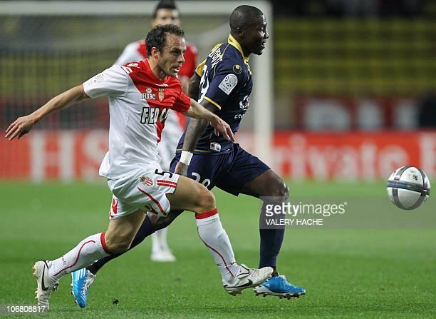 Monaco's French defender Laurent Bonnart vies with ArlesAvignon's FrenchIvorian forward Franck Dja Djedje during their French L1 football match...