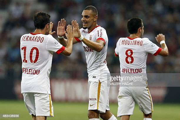 Monaco's French defender Layvin Kurzawa celebrates with Portuguese midfielders Bernardo Silva and Joao Moutinho after scoring his team's second goal...