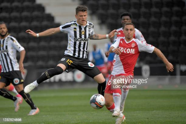 Monaco's French defender Ruben Aguilar fights for the ball with Angers' French midfielder Pierrick Capelle during the French L1 football match...