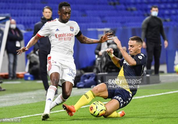 Monaco's French defender Ruben Aguilar vies with Lyon's French midfielder Tino Kadewere during the French L1 football match between Olympique...