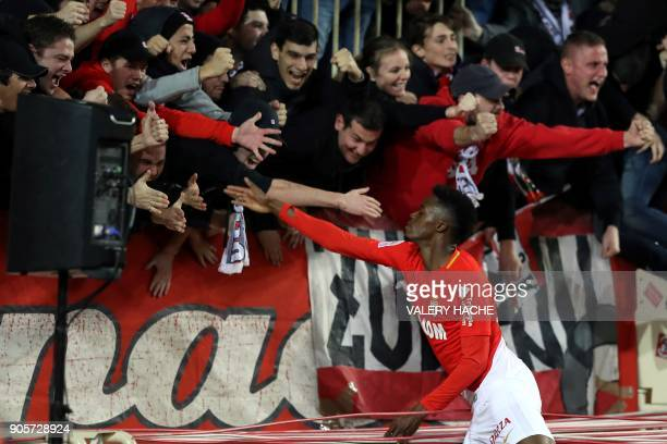 Monaco's French forward Adama Diakhaby celebrates with supporters after scoring a goal during the French L1 football match Monaco vs Nice on January...