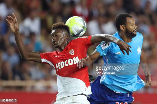 Monaco's French forward Adama Diakhaby vies for the ball with Marseille's Portuguese defender Rolando during the French L1 football match between...