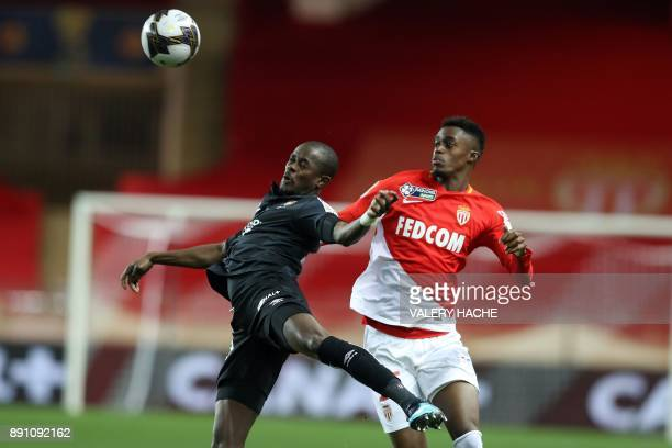 Monaco's French forward Adama Diakhaby vies with Caen's Christian Kouakou during the French League Cup round of 16 football match between Monaco and...