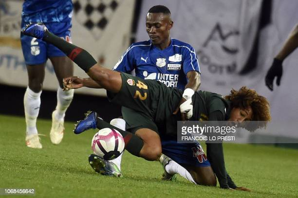 Monaco's French forward HanNoah Massengo falls past Amiens' Beninese defender Khaled Adenon during the French L1 football match between Amiens SC and...