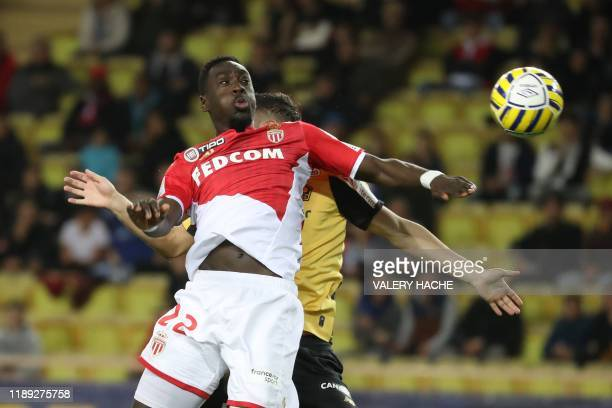 Monaco's French forward Jean-Kevin Augustin vies with Lille's French defender Jeremy Pied during the French League Cup football match between Monaco...