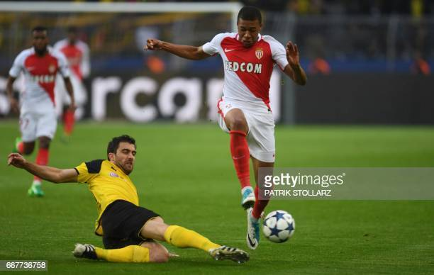 Monaco's French forward Kylian Mbappe Lottin and Dortmund's Greek defender Sokratis vie for the ball during the UEFA Champions League 1st leg...