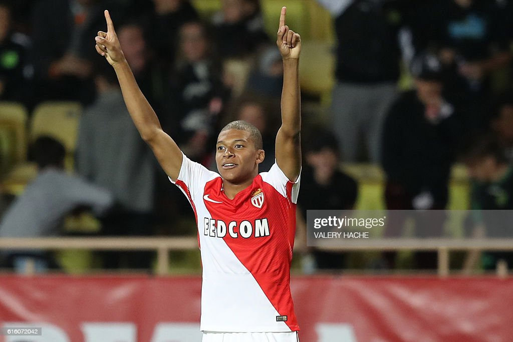 Monaco's French forward Kylian Mbappe Lottin celebrates after scoring a goal during the French L1 football match between AS Monaco and Montpellier at the Louis II Stadium in Monaco on October 21, 2016. / AFP / VALERY