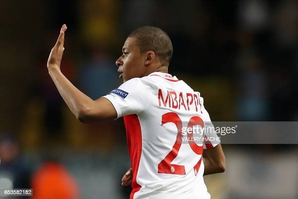 Monaco's French forward Kylian Mbappe Lottin celebrates after scoring a goal during the UEFA Champions League round of 16 football match between...
