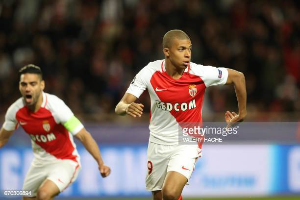 Monaco's French forward Kylian Mbappe Lottin celebrates after scoring a goal during the UEFA Champions League 2nd leg quarterfinal football match AS...