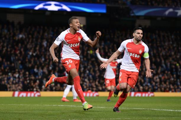 Monaco's French forward Kylian Mbappe Lottin celebrates scoring their second goal during the UEFA Champions League Round of 16 first-leg football...