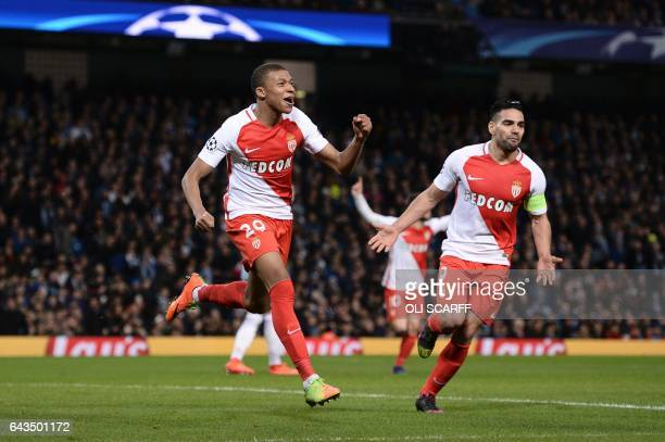 Monaco's French forward Kylian Mbappe Lottin celebrates scoring their second goal during the UEFA Champions League Round of 16 firstleg football...