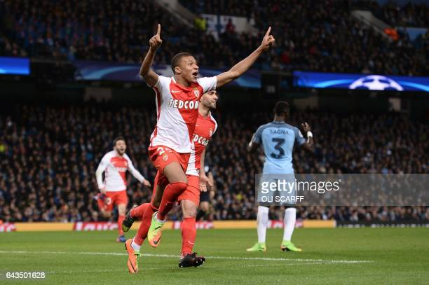 Monaco's French forward Kylian Mbappe Lottin celebrates scoring their second goal woth Monaco's French defender Benjamin Mendy during the UEFA...