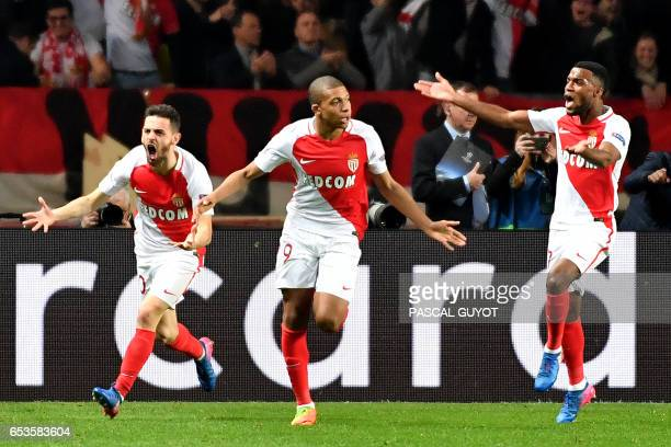 Monaco's French forward Kylian Mbappe Lottin celebrates with Monaco's Portuguese midfielder Bernardo Silva and Monaco's French midfielder Thomas...