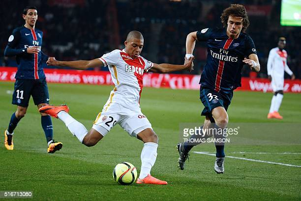 Monaco's French forward Kylian Mbappe Lottin challenges Paris SaintGermain's Brazilian defender David Luiz during the French L1 football match...
