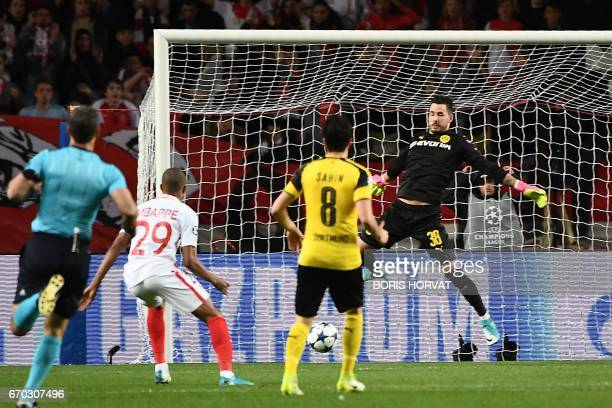 Monaco's French forward Kylian Mbappe Lottin opens the scoring during the UEFA Champions League 2nd leg quarterfinal football match AS Monaco v BVB...