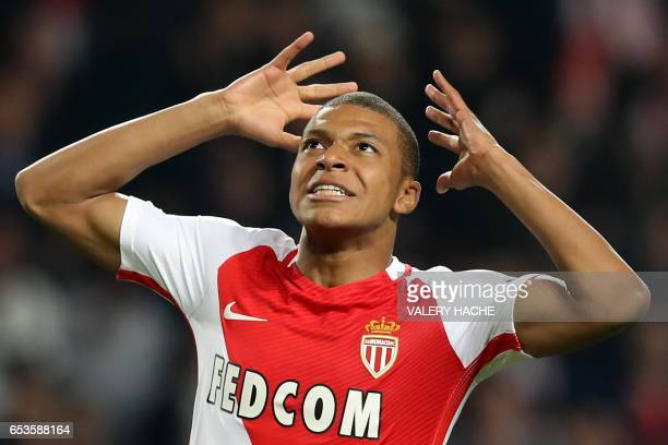 Monaco's French forward Kylian Mbappe Lottin reacts after missing a goal opportunity during the UEFA Champions League round of 16 football match...