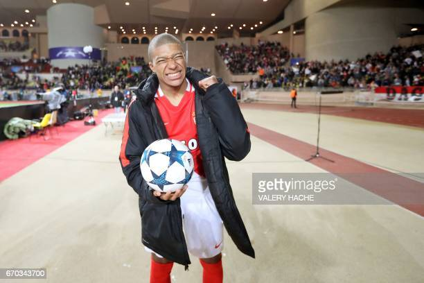 Monaco's French forward Kylian Mbappe Lottin reacts after Monaco defeated Dortmund during the UEFA Champions League 2nd leg quarterfinal football...